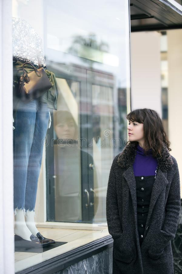 Woman Walking In The City and Window Shopping royalty free stock photo