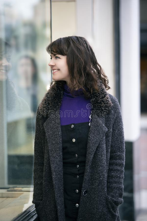 Woman Walking In The City and Window Shopping royalty free stock image