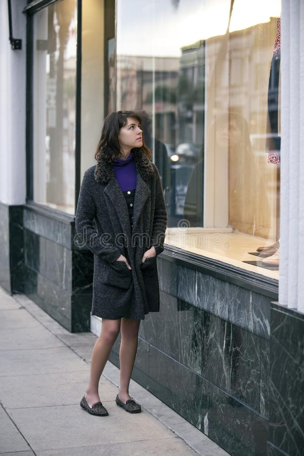 Woman Walking In The City and Window Shopping royalty free stock images
