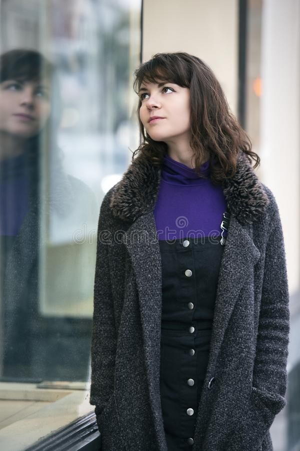Woman Walking In The City and Window Shopping stock images