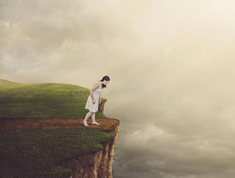 Woman walking on cliff. royalty free stock photo