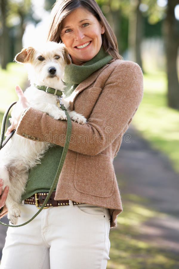 Download Woman Walking Dog Outdoors In Autumn Park Stock Photo - Image: 13673708