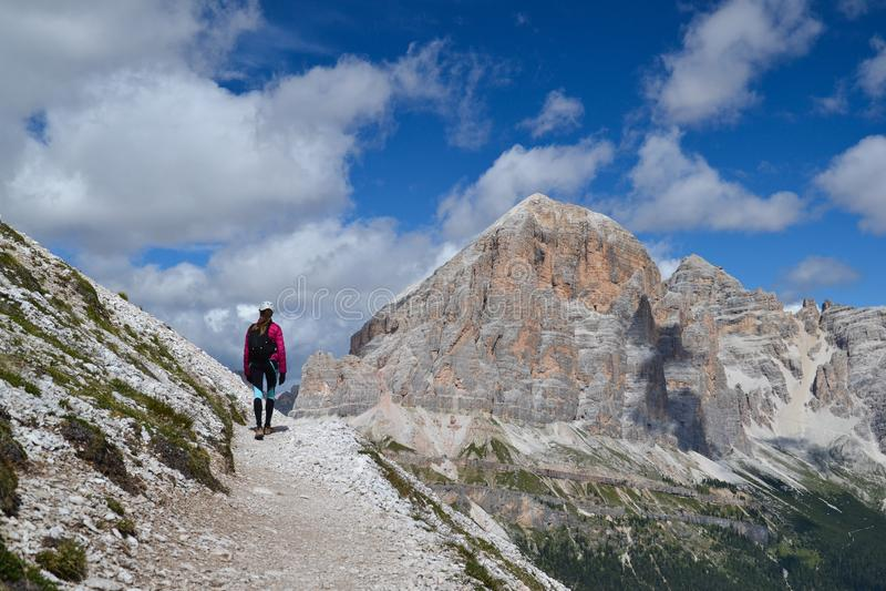 Woman walking in Dolomite mountains stock photos