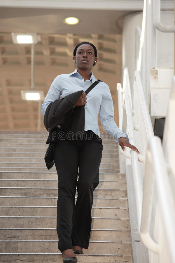 Free Woman Walking Down A Staircase Stock Photography - 14537382