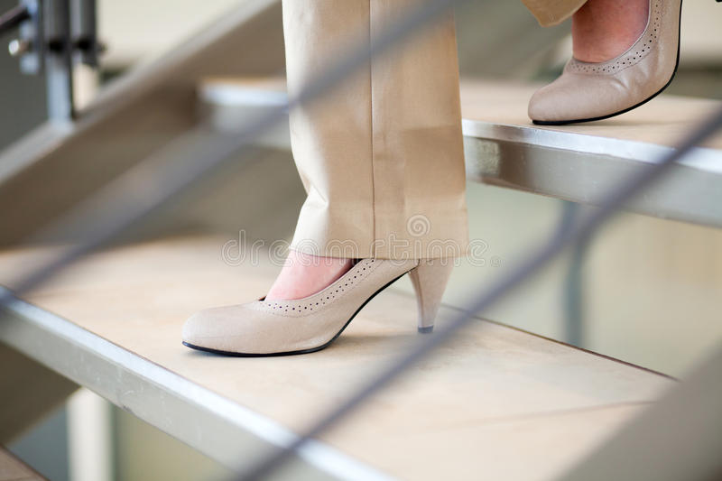 Download Woman walking down stairs stock photo. Image of feet - 26055178