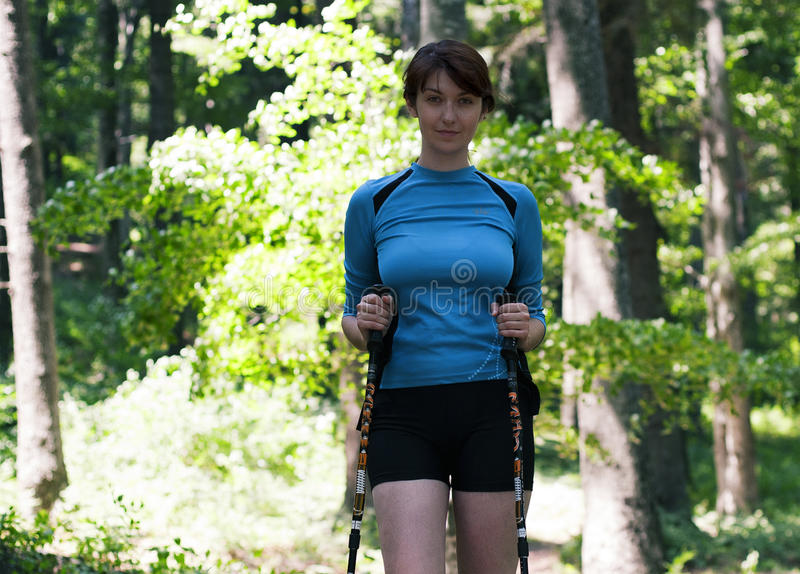 Woman walking in the forest. In a summer day royalty free stock photography