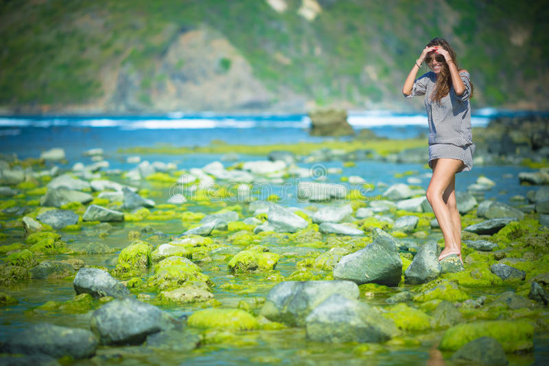 Woman Walking on the Green Reef royalty free stock photos