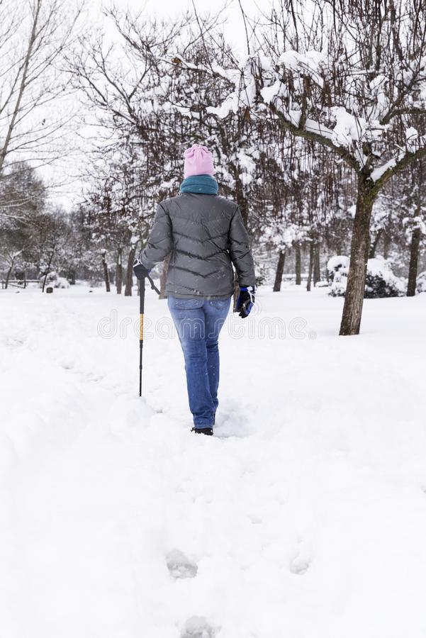 Woman walking and having fun on a cold winter day stock photography