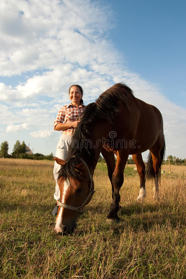 Download Woman Walking With Her Horse Royalty Free Stock Photos - Image: 21568368