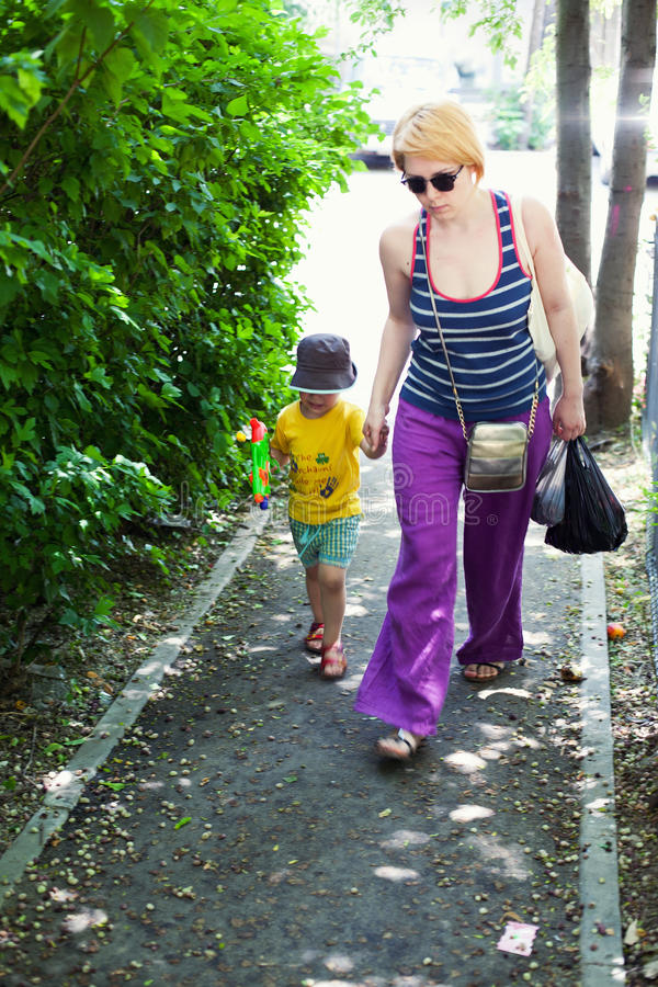 Download Woman walking with her son stock image. Image of caucasian - 23269519