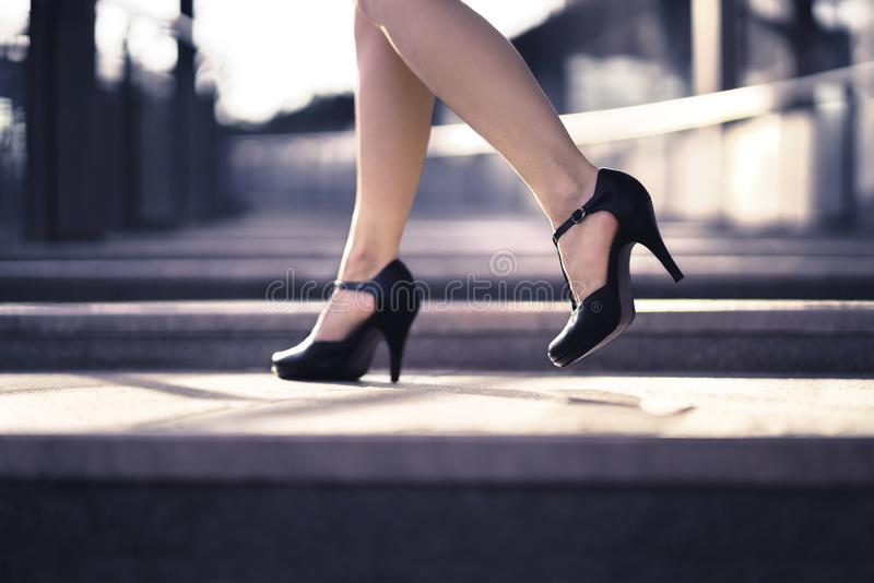 Woman walking in high heels in urban city street in summer. Chic stylish footwear. Elegant fashion style. stock photography