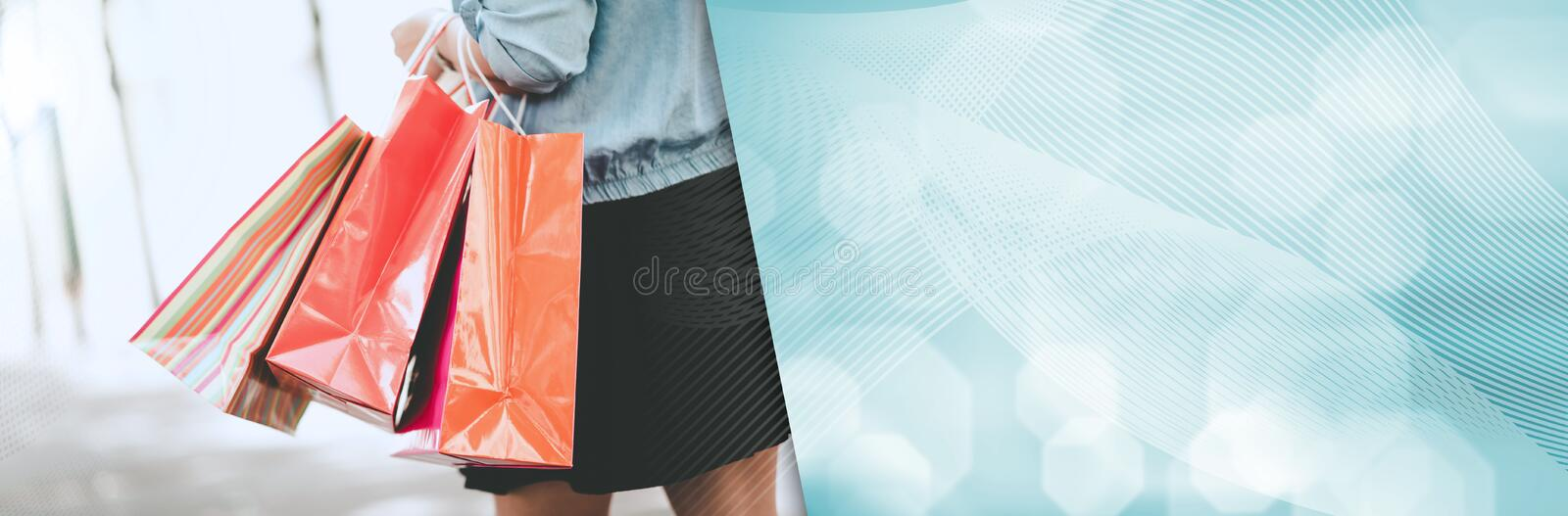 Woman walking and holding shopping bags. panoramic banner royalty free stock photo