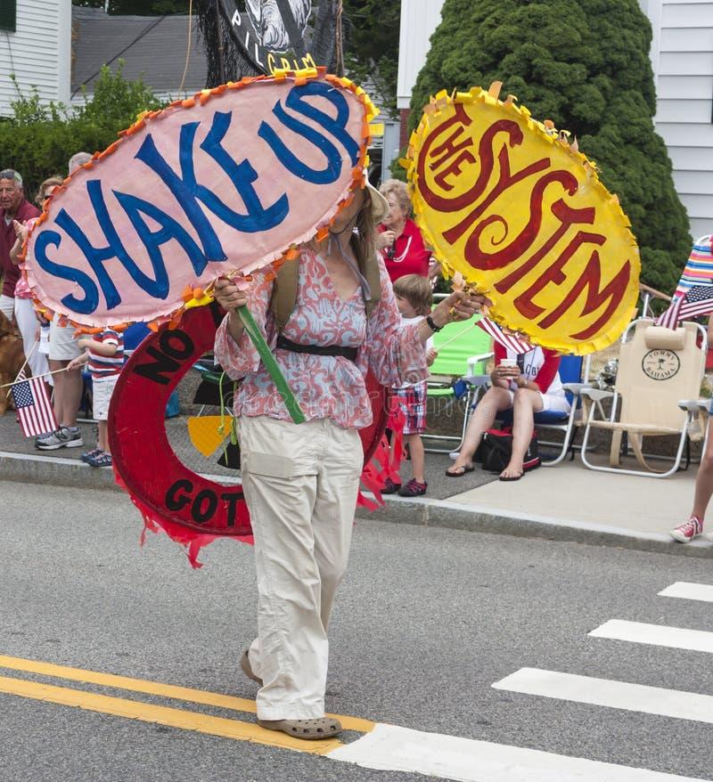 Free Woman Walking In The Wellfleet 4th Of July Parade In Wellfleet, Massachusetts. Stock Photos - 42553613