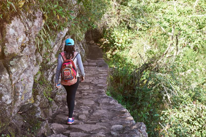Woman walking on inca trail royalty free stock images