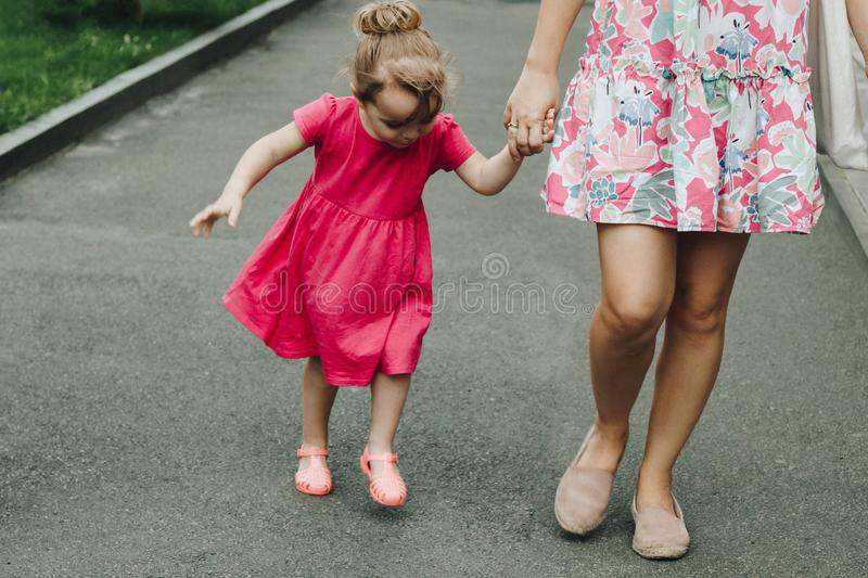 Woman walking with little girl royalty free stock photo