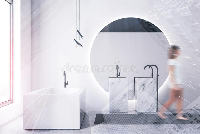 Woman walking in luxury white bathroom. Young woman in casual clothes walking in luxury bathroom with white walls, concrete floor, double marble sink with large stock image