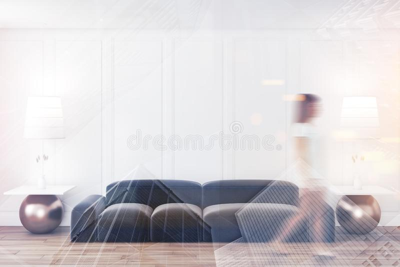 Woman walking in minimalistic white living room. With gray sofa and two coffee tables. Toned image double exposure blur stock images