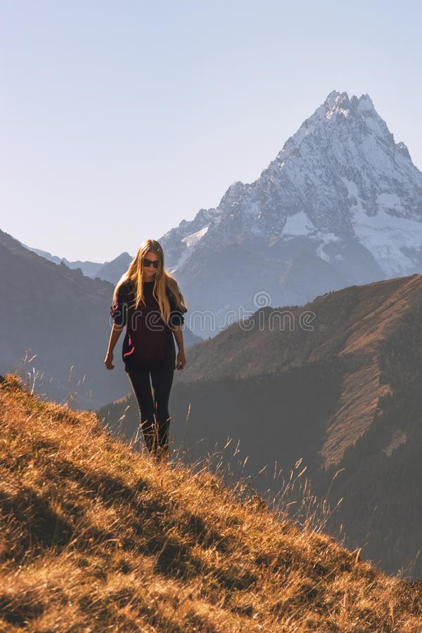 Woman walking in mountains alone travel adventure stock photos
