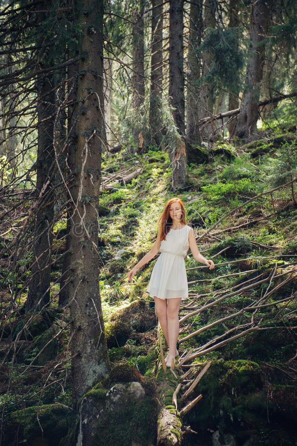 Woman walking in the mystery forest stock photos