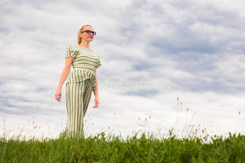 Woman walking in nature royalty free stock photography