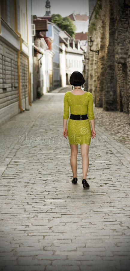 Woman walking in the Old Town of Tallinn royalty free stock photos