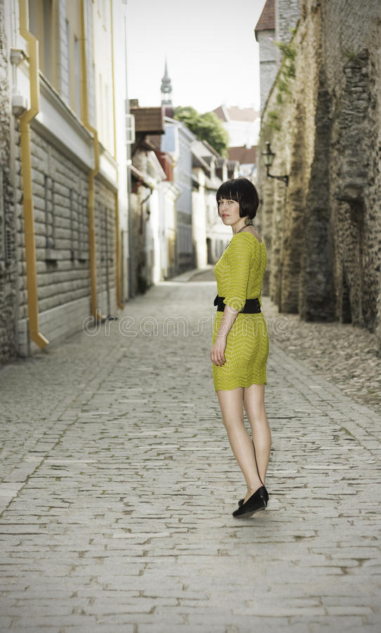 Woman walking in the Old Town of Tallinn stock photos