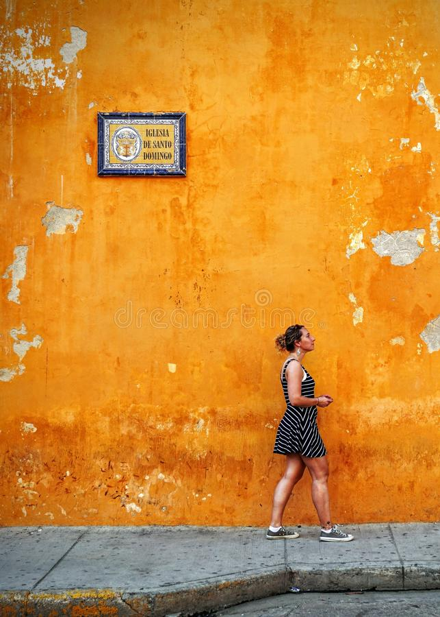 Woman Walking Beside Orange Painted Wall Free Public Domain Cc0 Image