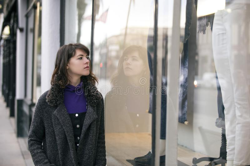 Woman Walking In The City and Window Shopping stock photography