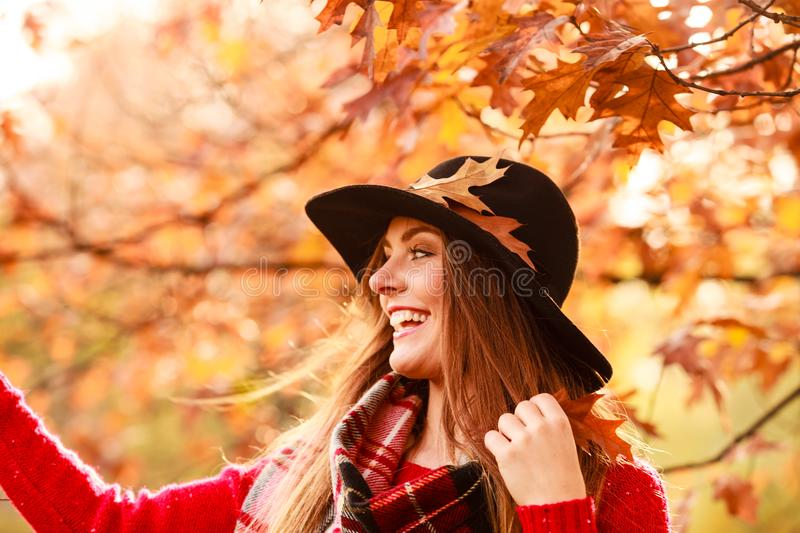 Woman walking in park during autumn royalty free stock image