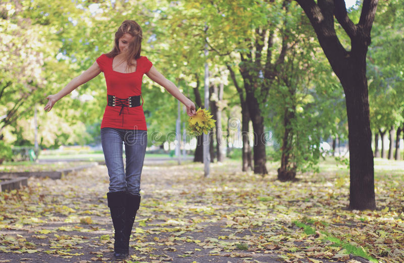 Woman walking in park stock images