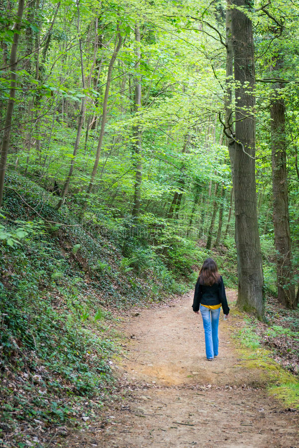 Woman walking on a path royalty free stock photo