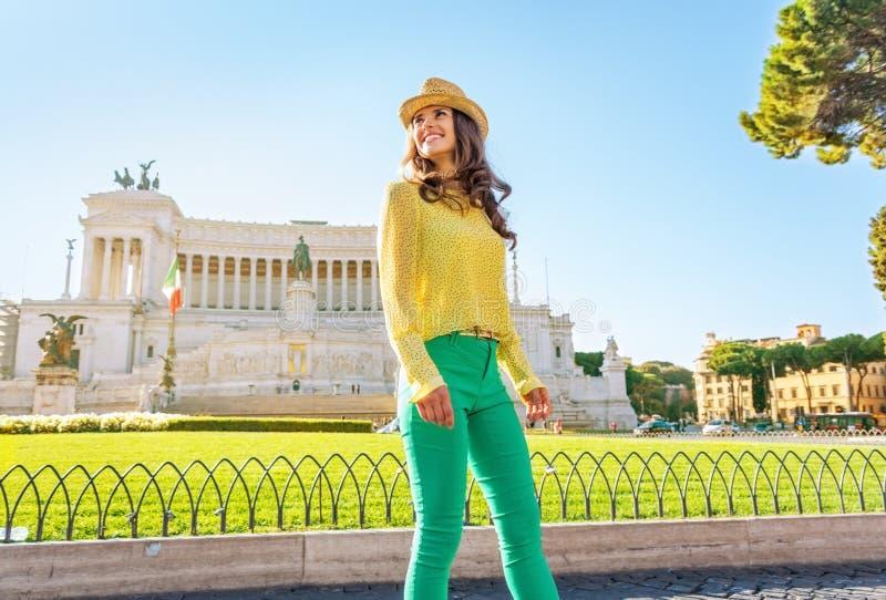 Woman walking on piazza venezia in rome, italy. Happy young woman walking on piazza venezia in rome, italy stock photo