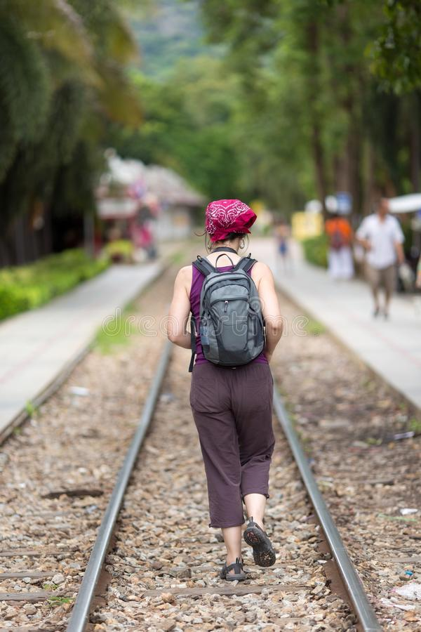 Woman walking on railway stock photography