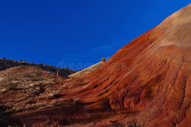 Woman walking by the red hill in Oregon. stock photo