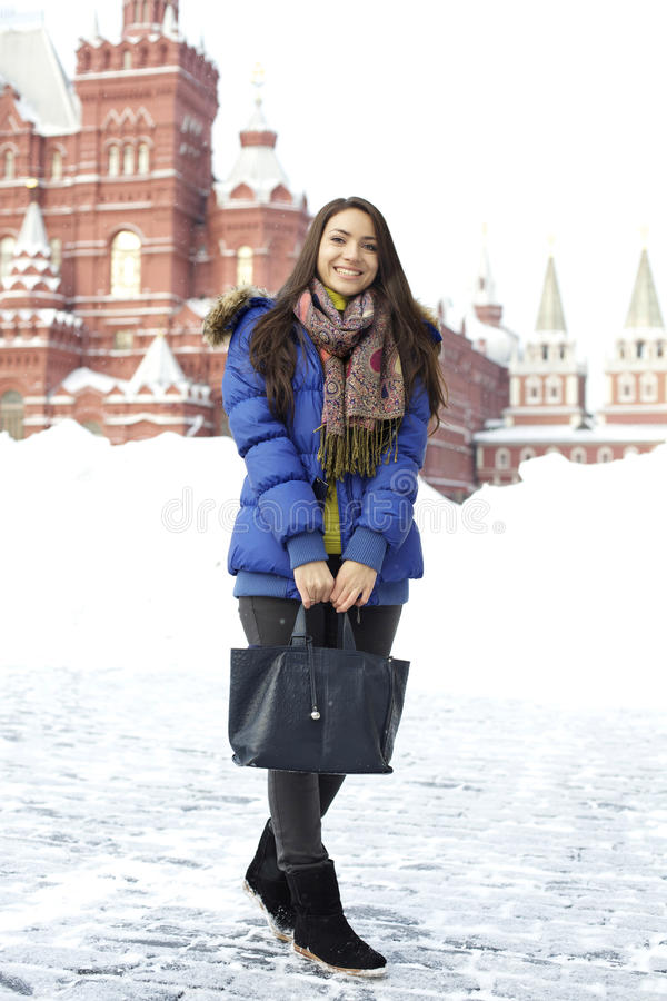 Woman walking on the Red Square in Moscow. A young woman walking on the Red Square in Moscow stock photos