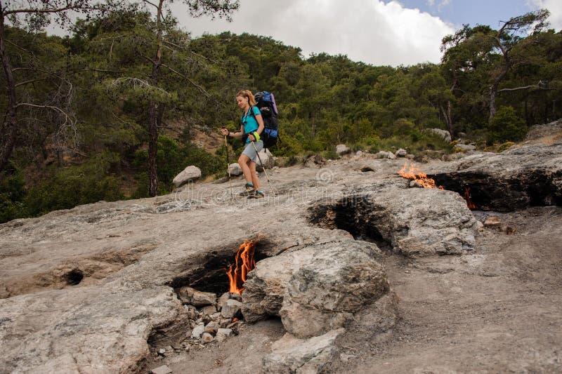 Woman walking on the rocks of the Chimaera mountain royalty free stock photos