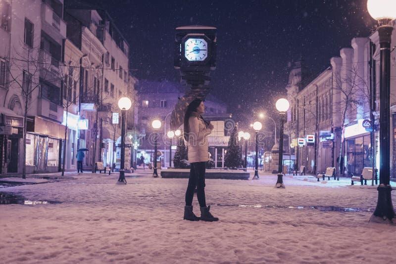 Woman Walking on Street Near Light Post during Winter Season royalty free stock images
