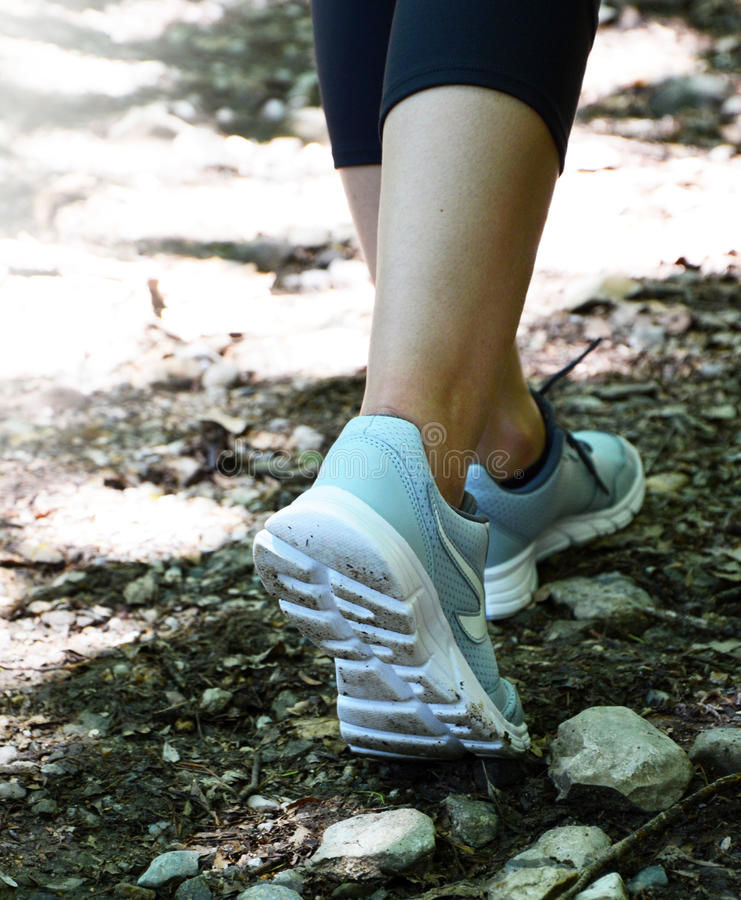 Woman Walking on trail Outdoor Jogging exercise royalty free stock images