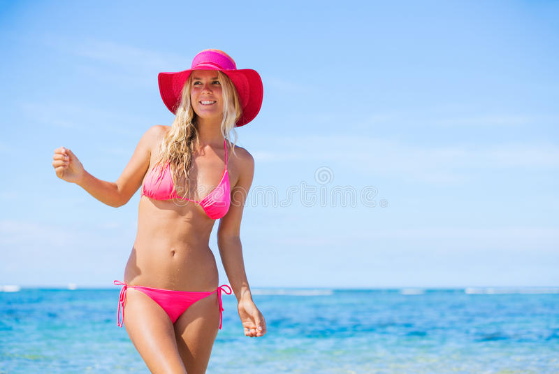Woman walking on tropical beach stock photography