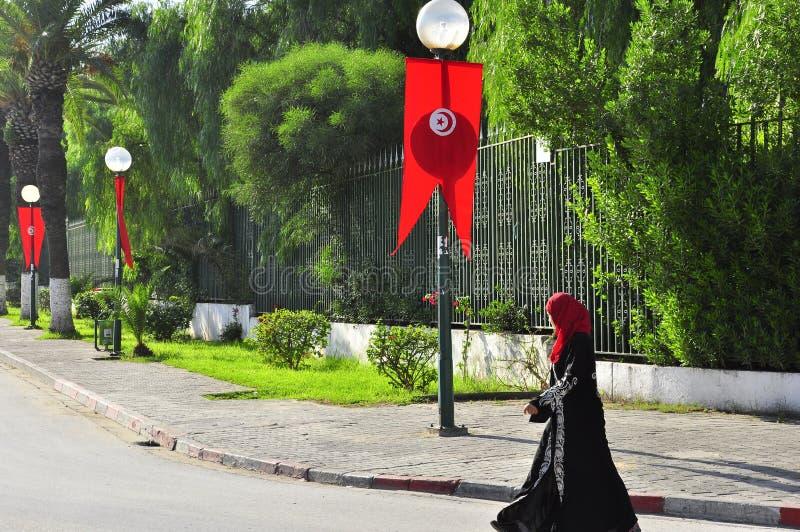 Woman walking on Tunisian street decorated