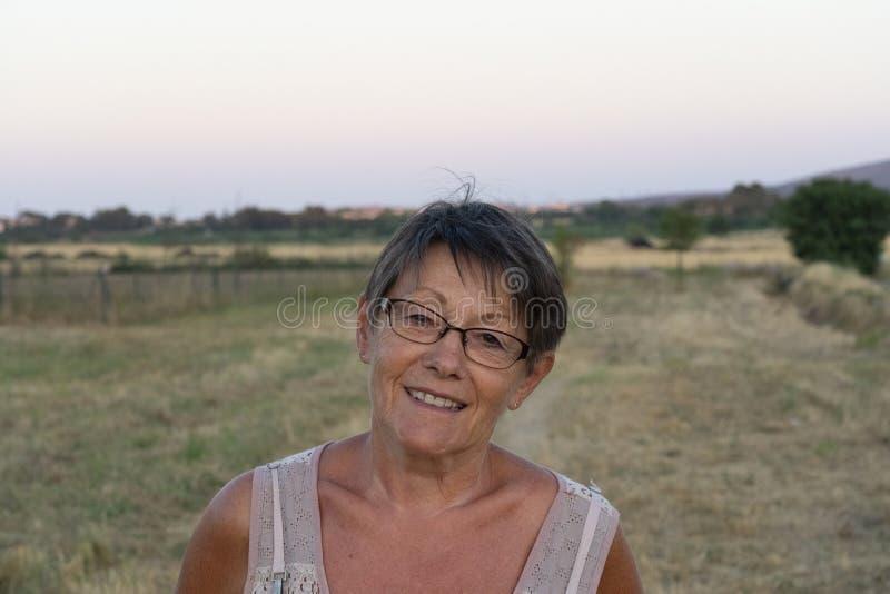 Woman walking in the vineyard stock photo