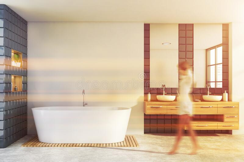 Woman walking in white and gray bathroom stock photography