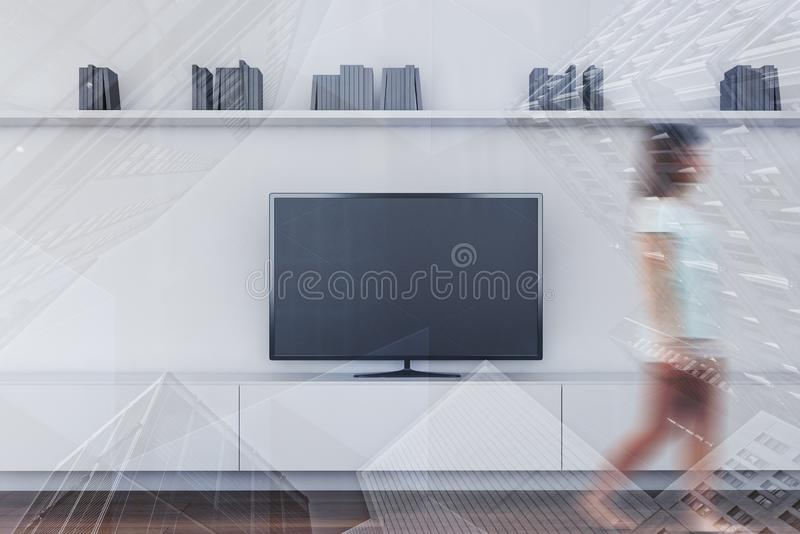 Woman walking in white living room with TV stock photography