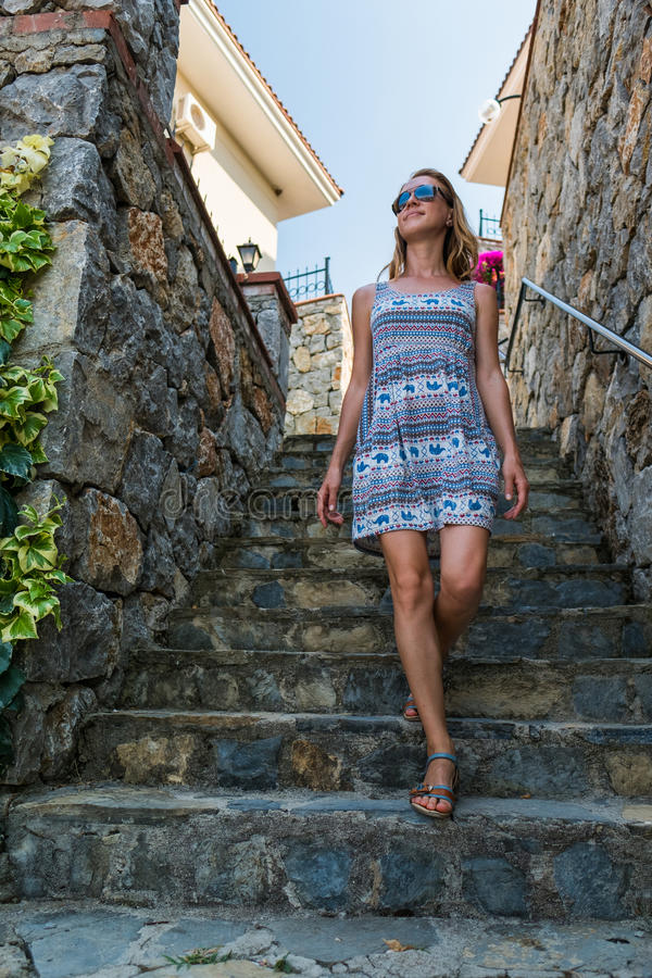Woman walks down the tiled stairs stock photography