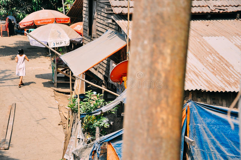 A woman walks in a small village in Myanmar. royalty free stock photography