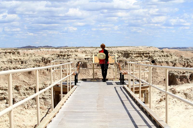 Woman on walkway in the Badlands National Park, South Dakota. stock photo