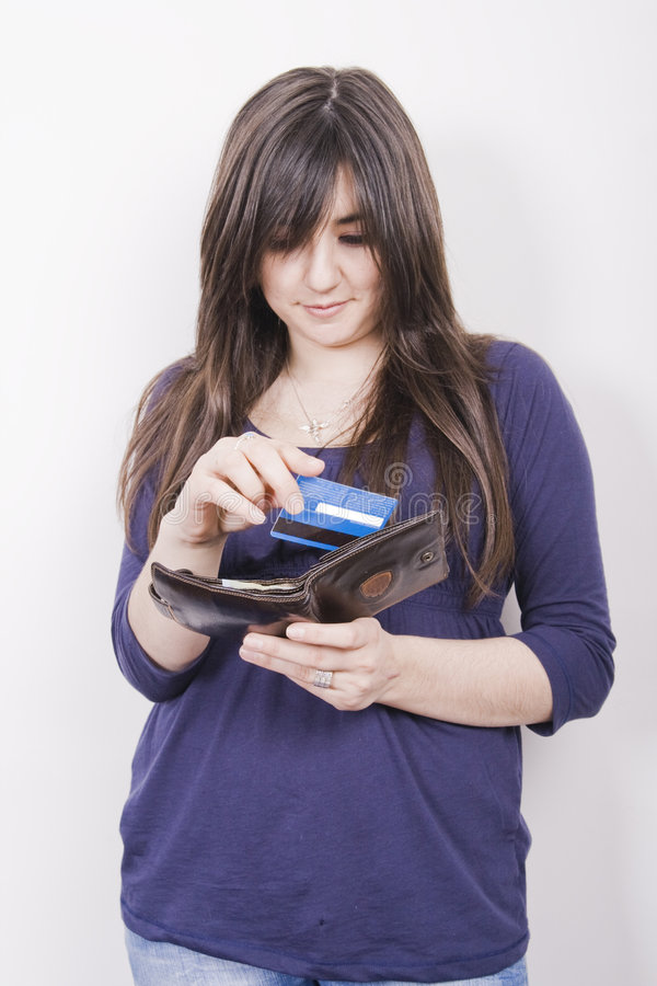 Woman with wallet. Young woman holds wallet with credit cards stock image