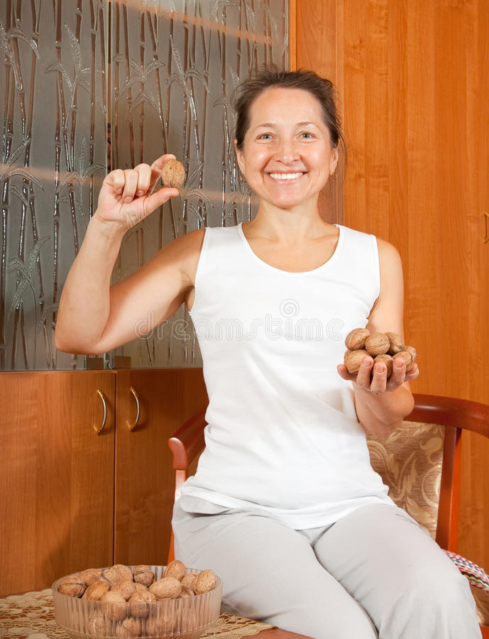 Woman With Walnuts Royalty Free Stock Photo