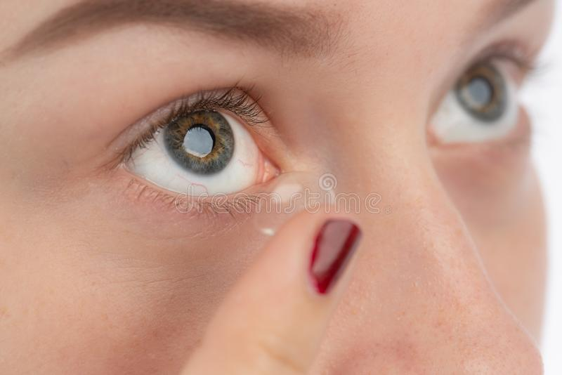 A woman wants to use a contact lens. Close-up of how a woman wants to use a contact lens royalty free stock images