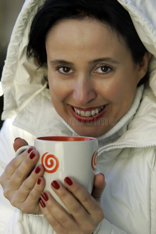 Woman with warm cup of tea